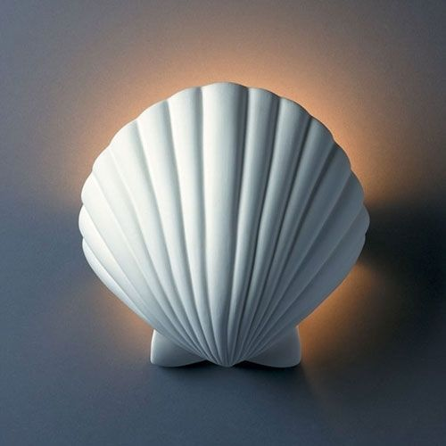 Shell Wall Sconce Light: http://beachblissliving.com/beach-lamps-and-pendant-lights/ Beach and coastal decor