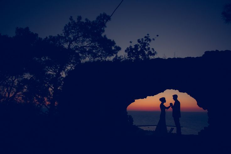 Holding hands as the sun sets in Kalamata