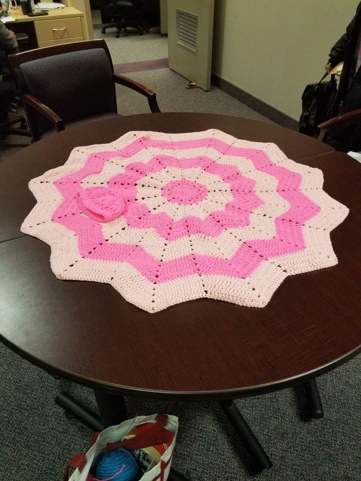 Homemade crochet baby blanket with cap