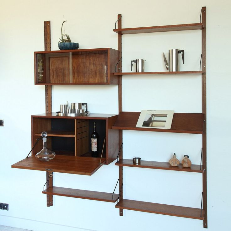 Poul Cadovius wall units system in teak from the 1960's. It is composed of six shelves, a container with sliding glass doors and a second container with a flap. Danish modern Poul Cadovius Royal System design (1965).