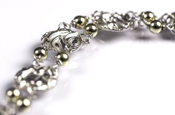 Designed and made by Nuit Nuit fine silver bracelet with 9 crt gold filled beads