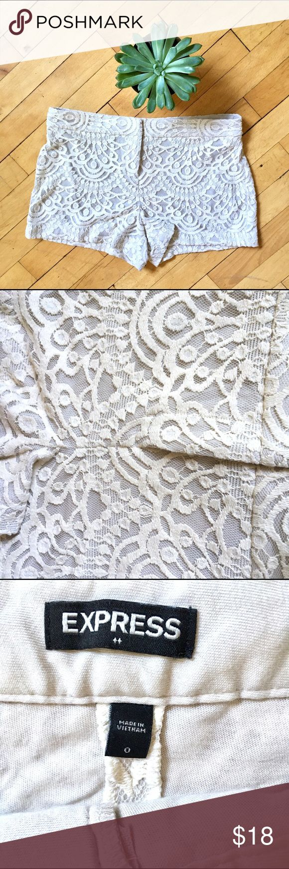 Express Crochet Lace Shorts Beautiful light cream Lace cream colored shorts from Express. Smooth fit with no pockets. Lined. Gently used and slightly faded but otherwise great condition. Can be dressed up or down! Size 0. Express Shorts