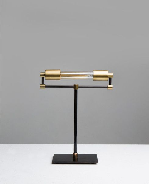 This is a very unique rendition of a bankers desk lamp. The bulb is 30 watts, making it very easy on the eyes. The lamp itself is made of brass while the base i
