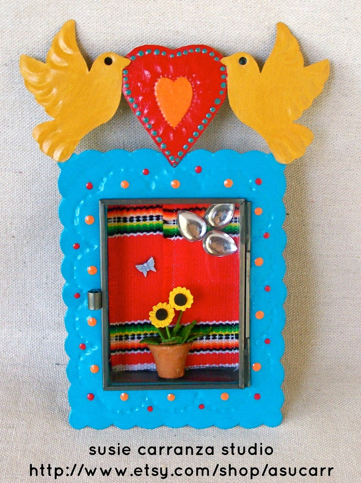 Handpainted Tin Nicho - Two Birds Holding Heart.  Mexican folk art by Susie Carranza. $38.00, via Etsy.
