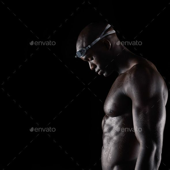 Strong male swimmer after training session - Stock Photo - Images