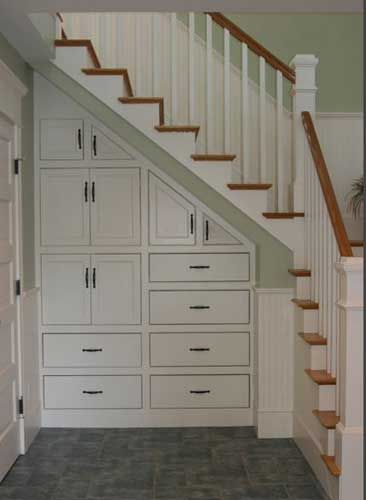 WOW - this is pretty and efficient.  Architectural Detail - Under stair storage (Step Design Laundry Rooms)