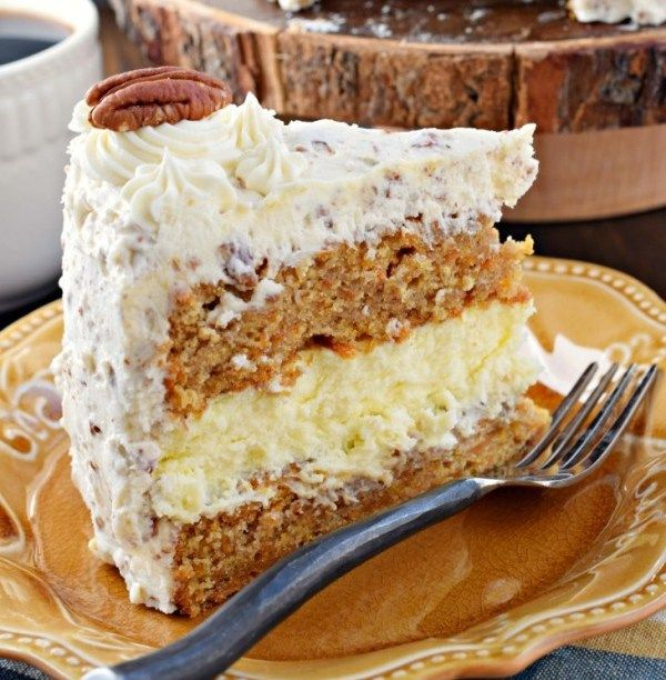 Carrot Cake Cheesecake Cake This Carrot Cake Cheesecake Cake recipe is a showstopper! Layers of homemade carrot cake, a cheesecake center and it's all topped with a delicious cream cheese frosting! Ingredients: For the carrot cake layers: 2