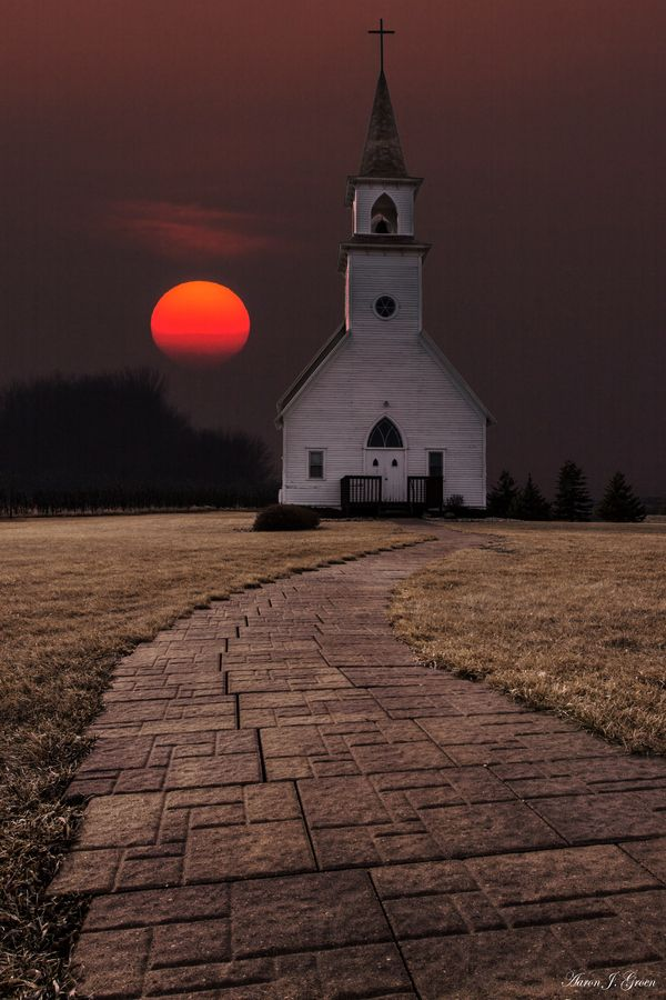 """""""Fort Belmont Sunset"""" by Aaron J. Groen.......Sun setting behind the 1902 Delafield Church. Taken Easter Sunday 3-31-13 at Fort Belmont in Jackson, Minnesota."""