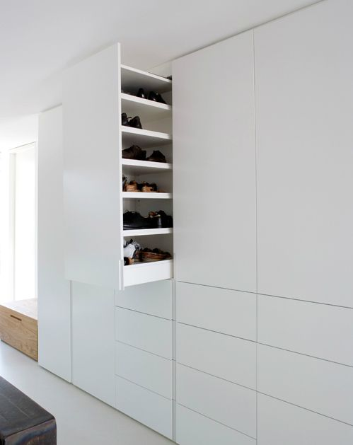 retractable cupboard | for storing shoes | by holzrausch.
