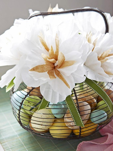 Flower arrangement using wire basket and Easter eggs.