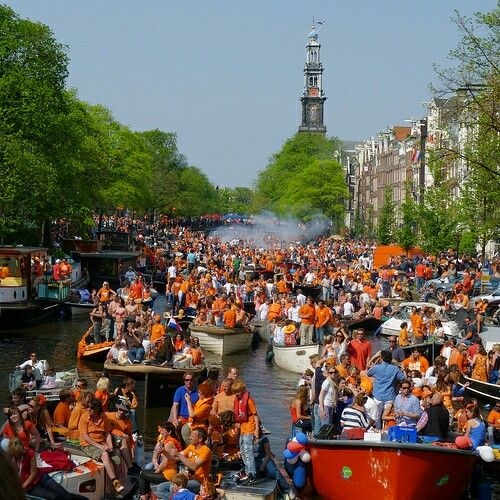 The Dutch celebrating Kingsday in the Amsterdam channels.