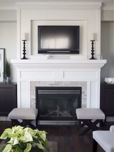 stunning diy fireplace update. This is the exact lay out of my formel living room with windows & built in shelves on each side. I would never paint my brick or masonry but I love the tv over it, I don't have one at all in that room now. Its used primarily for rest, entertainment when I have large parties and family gatherings and I never wanted a tv for distraction.
