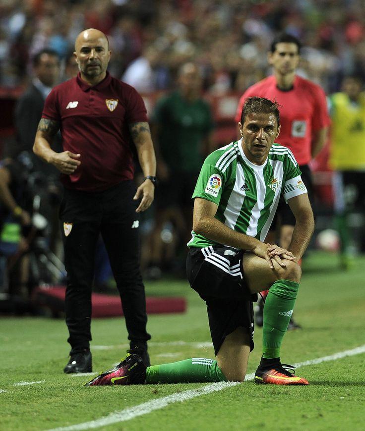 Betis' midfielder Joaquin looks on (R) past Sevilla's coach Jorge Sampaoli…