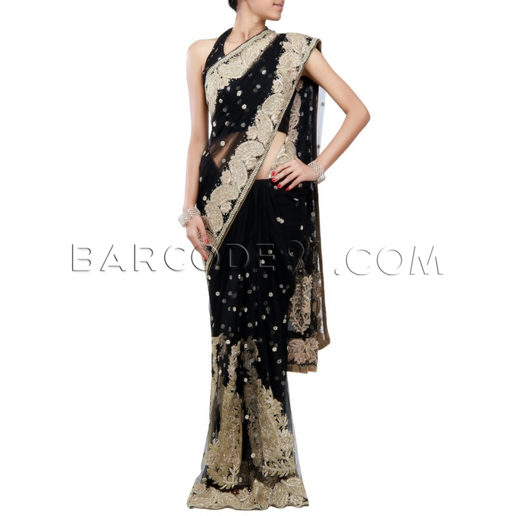 $398 Black net saree crafted and designed with gold zari and pearl work.It comes with net blouse with gold zari work.Slight variation is possible in color.