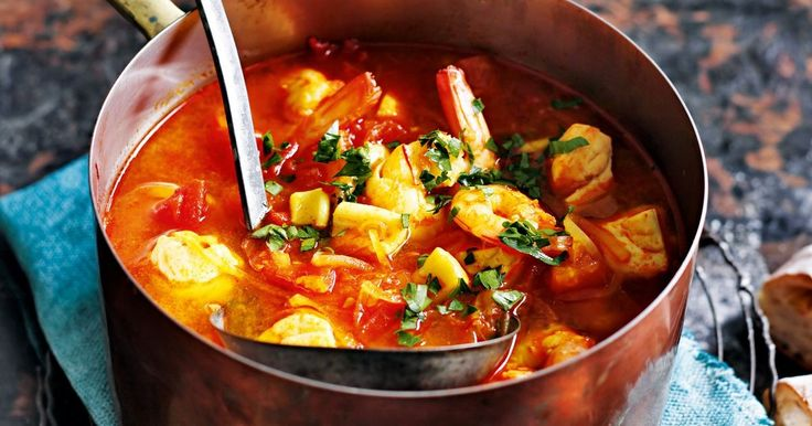 Ripe tomatoes add freshness and flavour to this succulent seafood soup.
