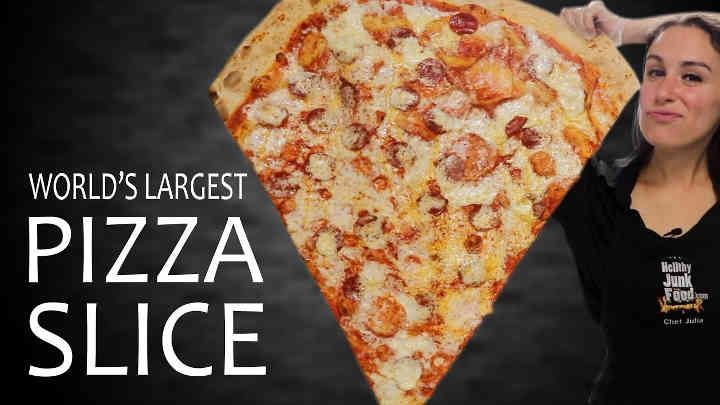 Hellthy Junk Food - World's Largest Pizza Slice. I can't imagine not being jealous of this pizza slice. I recommend anyone who watches this video...