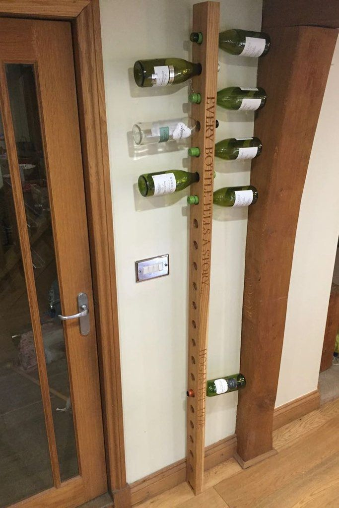 Large Oak Wine Rack £185.00  Our personalised racks are a fab way to display your wine and offer contemporary bottle storage.  The wall-mounted feature offers a space saving alternative to bulky constructions providing  a unique way to store your wine keeping them in a horizontal position as they should be kept.   This wine rack will hold 22 bottles and will stretch from nearly floor to ceiling offering a fabulous feature to any room...only task now is keeping it full!