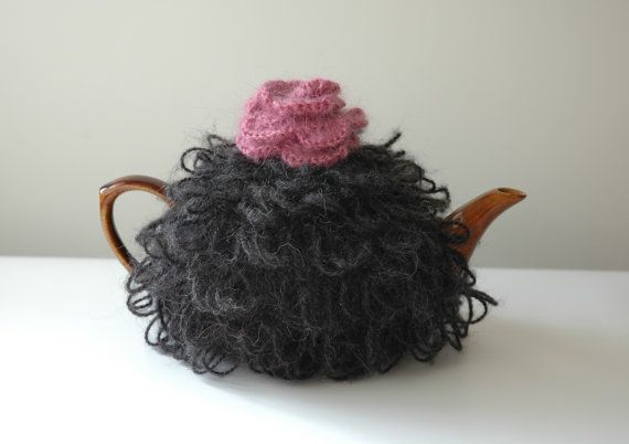 Knitted tea cosy in black mohair with a pink rose on top from KororaCrafters via Etsy