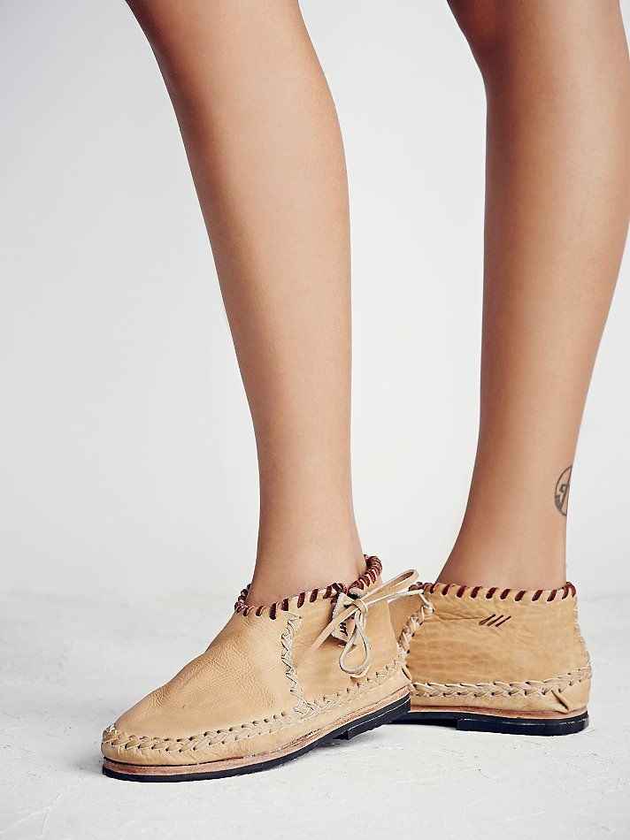 Never Lost Moccasin | Super soft and luxe slip-on leather moccasins featuring exposed braided and contrast stitching.  Lace-up, adjustable side ties.  Textured sole.