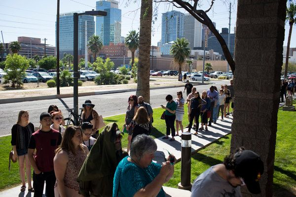 The long lines at Arizona polling places this week point toward potential problems ahead nationally at a time when 16 states will have new voting restrictions in place.