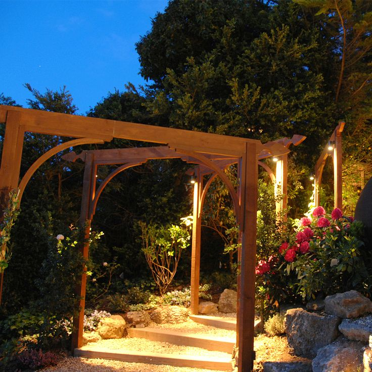 18 best outdoor lighting ideas images on pinterest exterior a warm ambient glow wraps around these rustic country garden arches demonstrating how you aloadofball Gallery