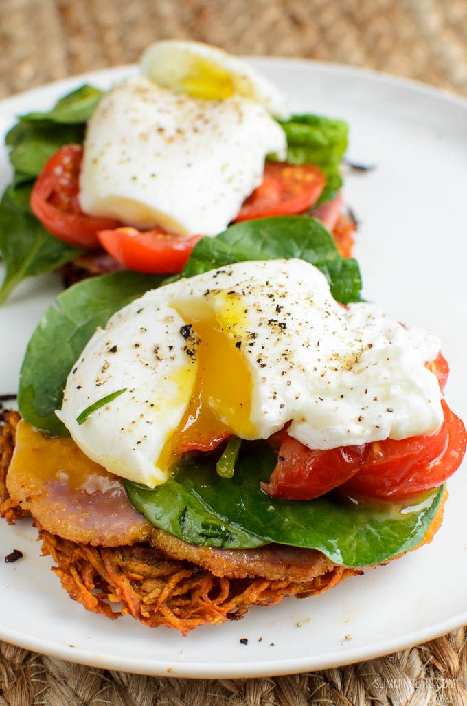 Sweet Potato Hash Brown Breakfast Stacks - topped with Canadian peameal bacon, spinach, ripe tomatoes and perfectly poached eggs.