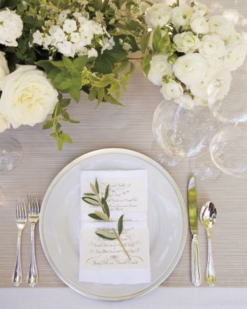 An olive-leaf sprig atop a classic wedding menu