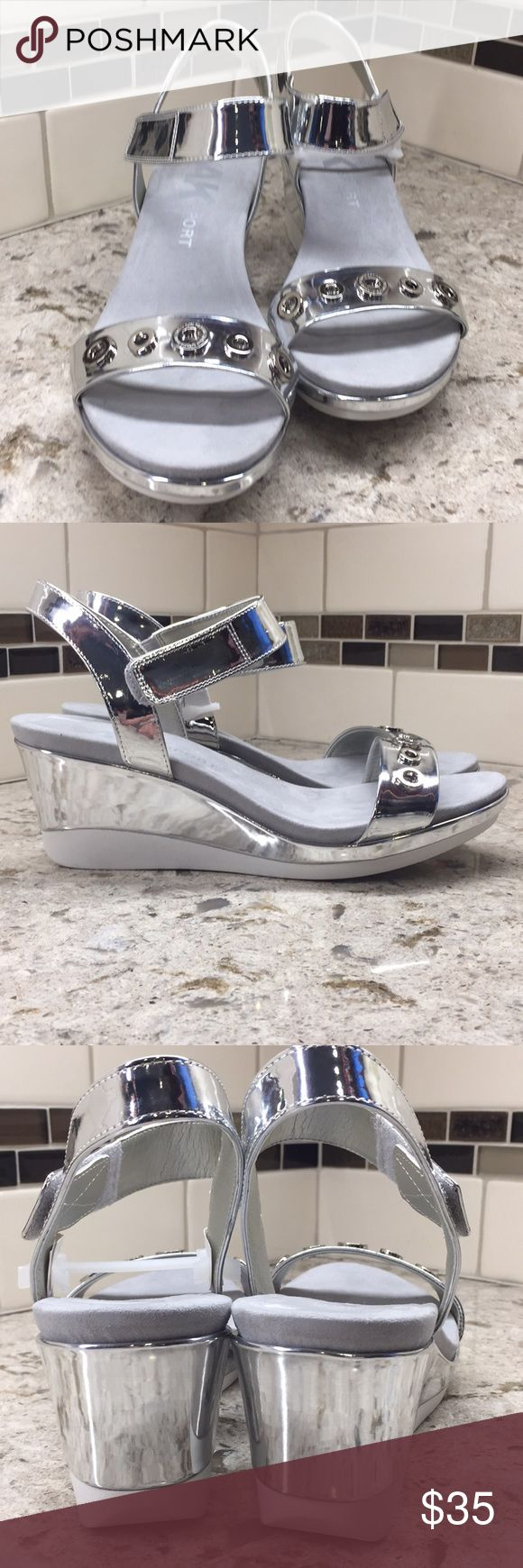 "Anne Klein Sport ""Pelonia"" silver wedge sandals New in box silver metallic wedge sandal with lots of style and comfort 3 inch wedge back and 1 inch platform front. Velcro ankle strap closure and grommet embellishment for extra style Anne Klein Sport Shoes Wedges"
