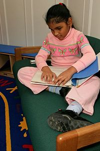 On the third day of the holidays, the Expanded Core Curriculum gave to me...compensatory academic skills! Here are some ideas from Emily to incorporate functional academic skills like braille literacy, organization, and concept knowledge into the holidays. (Image: girl reading braille, seated on a comfortable couch)