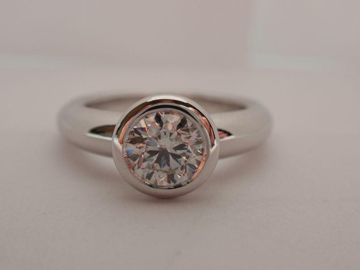 18 Krt whitegold bezel set ring with 1 ct brilliant cut diamond.