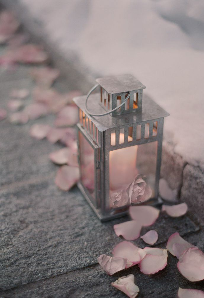 There's something romantic about a pink petaled path and a candle lantern to guide her feet...