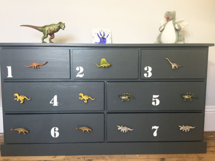 The Total Awesomeness of our customers never fails to Amaze me. Check out this BEAUT of a Chest of Drawers that one of our customers has just sent us. She's painted it charcoal, stenciled numbers on with white paint and Pimped it with 11 of our children's dinosaur cupboard & drawer knobs. It makes such a GREAT change from a natural wood chest or white paint look and would look Amazing in a boys or girls Dinosaur themed bedroom :) www.candyqueendesigns.co.uk