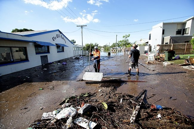 Local residents in Water St. Bundaberg. The clean-up begins. Picture: Mark Calleja