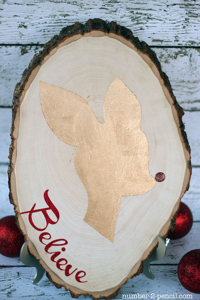Rudolph Silhouette Christmas Sign Tutorial- made with vinyl stencil, seal edges with matte mod podge to prevent paint from bleeding under!