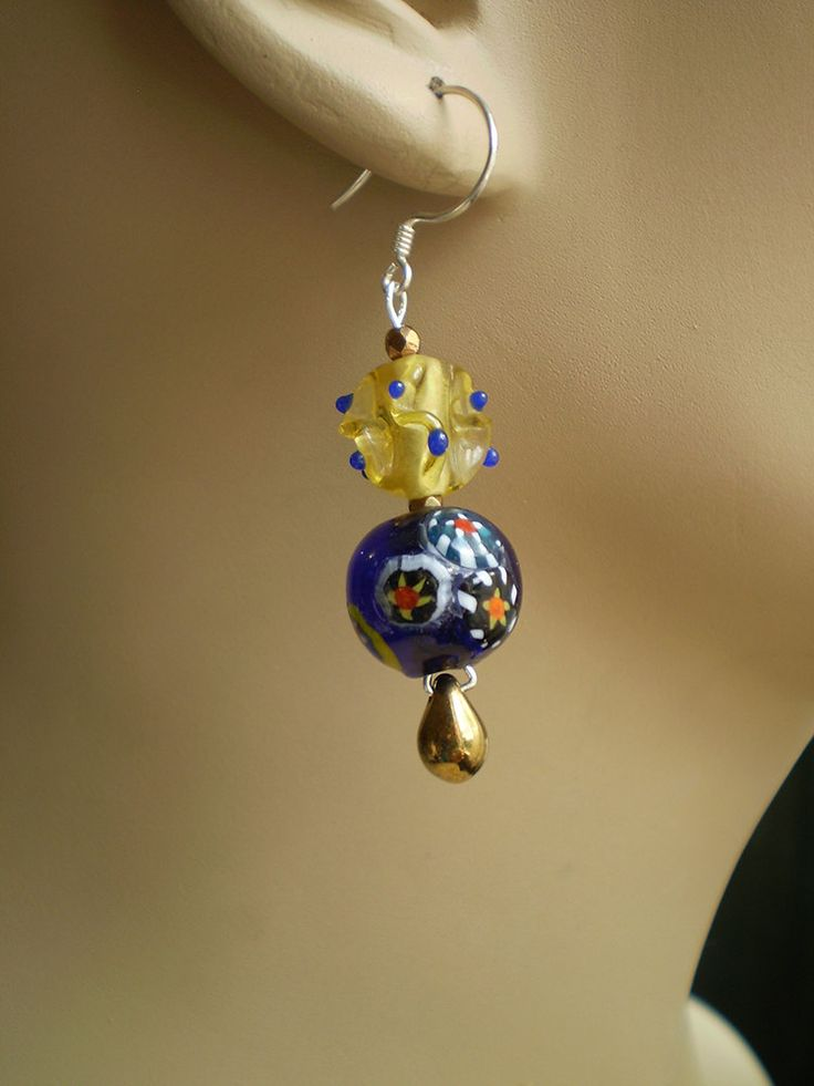 Starry night sky with yellow glass sun by EachBeadCounts on Etsy