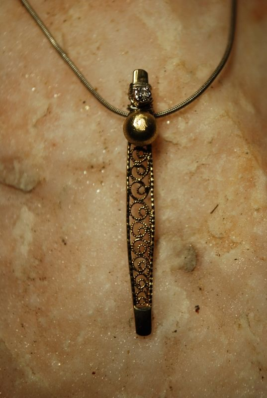 """Filigree stick"" by Angelina Croft, gold, silver and diamond pendant"