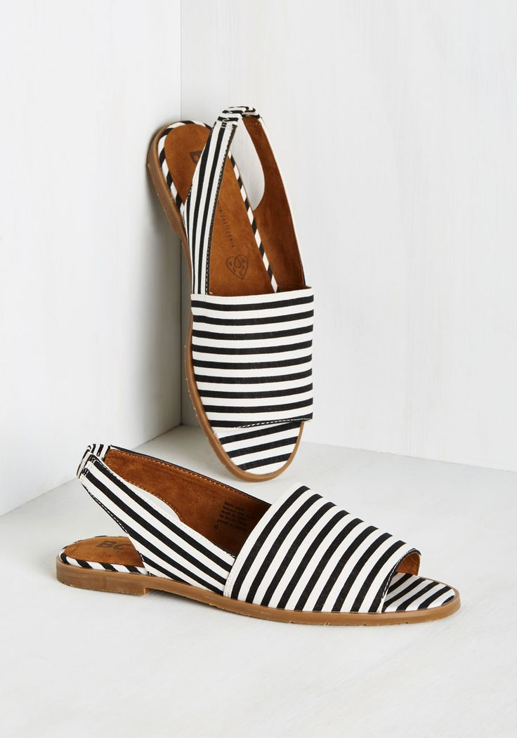 Put a boogie in your step with these black and white flats - don't keep  that pep of yours under 'raps'! With bold stripes and slingback straps,  these zesty ...