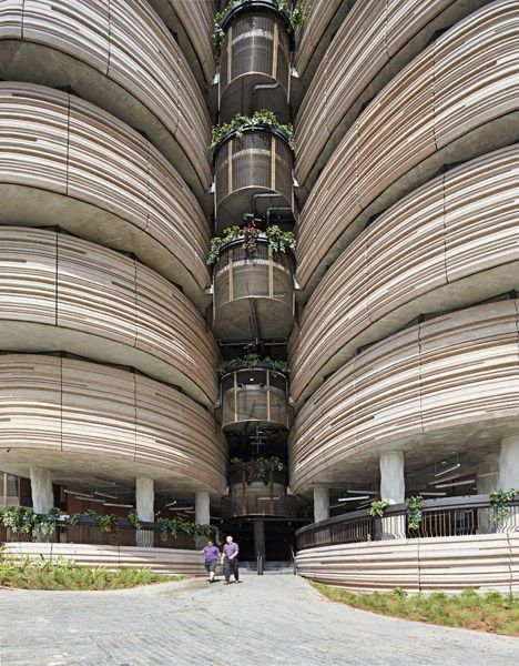 Heatherwick's textured-tower university building completes in Singapore.