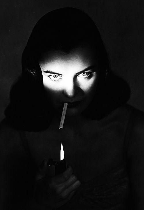 Ella Raines lighting a cigarette, 1940s.