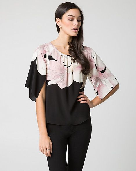 A big pink floral print on the black top. It catch my eyes on the floral.