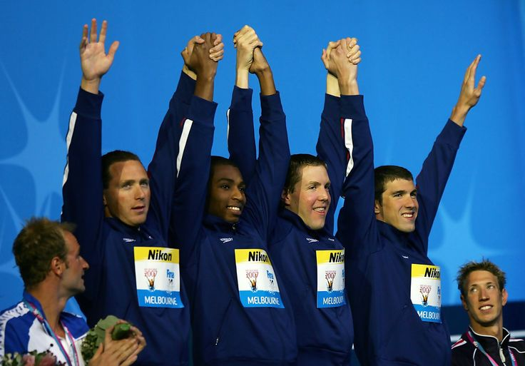 Michael Phelps Photos Photos - Gold medallists Michael Phelps, Cullen Jones, Neil Walker and Jason Lezak of the United States of America following for the Men's 4x100m Freestyle Relay final during the XII FINA World Championships at the Rod Laver Arena on March 25, 2007 in Melbourne, Australia. - XII FINA World Championships - Day 9