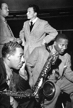 "Standing (left) Sy Oliver, standing (right) Frank Sinatra, Seated (left) Johnny Hodges, Seated (right) Harry Carney. Both saxophonists were major soloists with the Duke Ellington Orchestra's saxophone section.  The photograph taken in 1946 during a Metronome all-star recording session is from ""Sinatra An American Classic."""