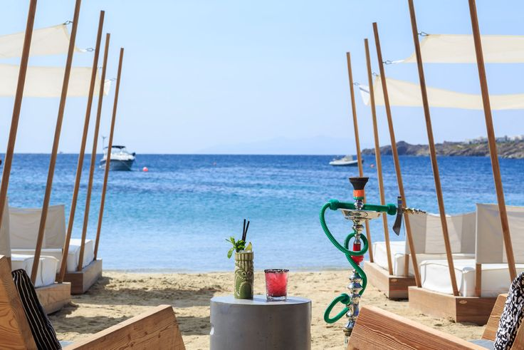 You know that you are on holiday when you are enjoying an ice cold tropical cocktail and a hookah on the Ornos beach in Mykonos! Amazing treats that can be found at Pasaji Mykonos. #PasajiMykonos #Pasaji #Mykonos #OrnosBeach #Ornos #Summer #GreekSummer #Restaurant #MykonosRestaurant #MykonosBar #MykonosFood #Greece #Cyclades #Cocktails