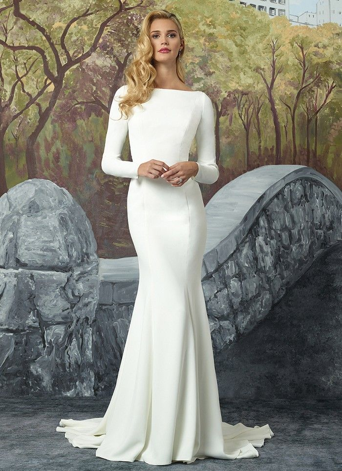 Turn heads with this crepe long sleeve fit and flare gown lined with Jersey from top to bottom. An elaborately beaded motif on the sheer illusion back shows that the beauty is all in the details. https://www.justinalexanderbridal.com/wedding_dresses/8936