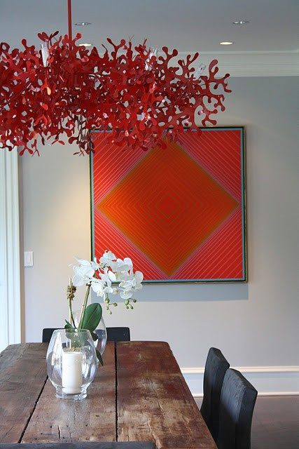 love this red coral chandelier, pop of color from the wall art & the reclaimed wood table