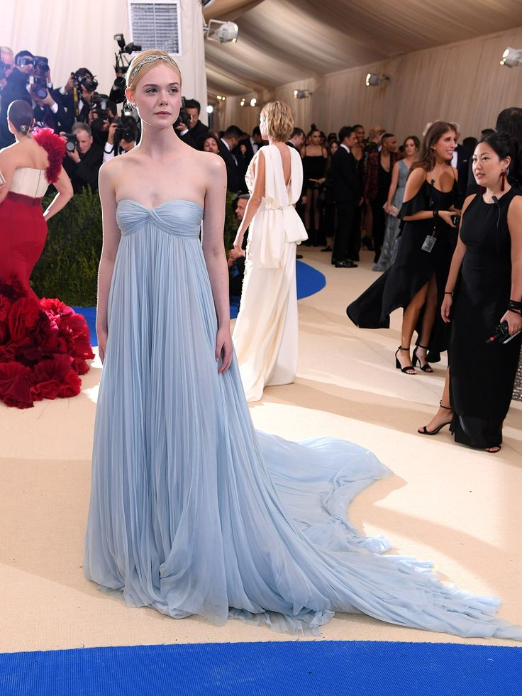 Elle Fanning is channeling Cinderella in a pale blue strapless dress with a long train that she's topped off with a headband.