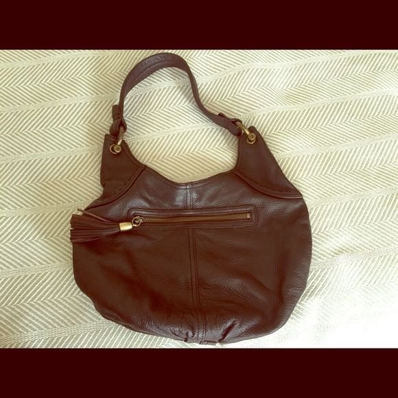 Lovely leather Gap purse with outside tassel pull Beautiful condition leather bag from Gap. This is a great quality leather bag with so much room and a classic style. Clean interior but a little staining due to age on the inside pocket. Lot of life in this baby-great for a college student! GAP Bags Hobos