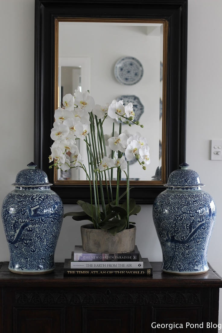 Orchid, ginger jars and mirror.  Chinoiserie