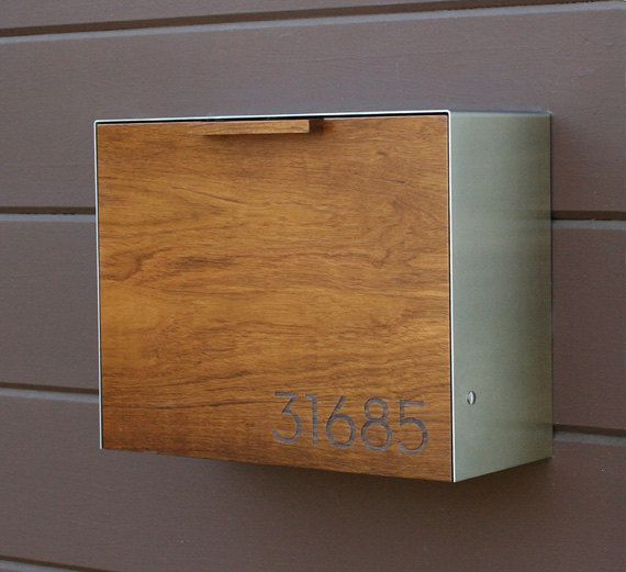 This Stainless Steel and Teak mailbox measures 14.5W x11.5H x 6D. I designed this mailbox after the 1950s black mailbox that used to hang on my house.