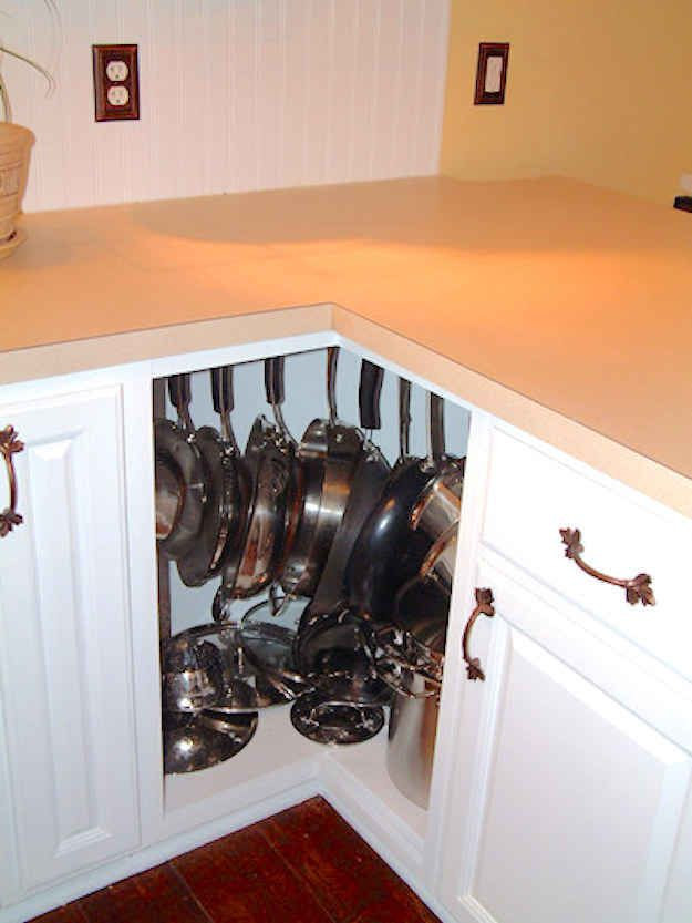 Use screw-hooks in the top of an awkward corner cabinet to turn it into a pot rack.